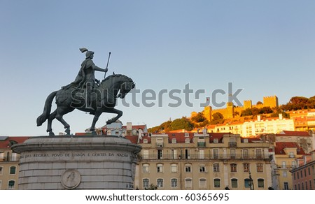 Statue of King Joao I at Figueiroa Square, and St. Jorge castle in Lisbon, Portugal