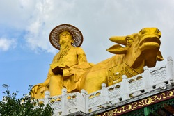 Statue of Laozi riding an ox east to return to the ancient Xuandu Palace in Dagushan, Dandong, Liaoning Province, China