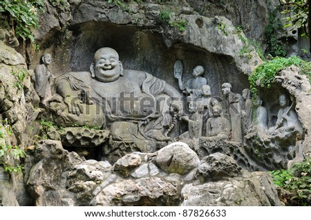 Statue of laughing buddha - stock photo