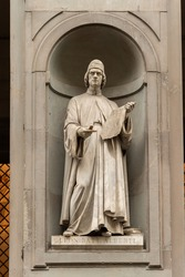 Statue of Leon Batt AlbertiI in the niches of the Uffizi Gallery colonnade, Florence Italy.