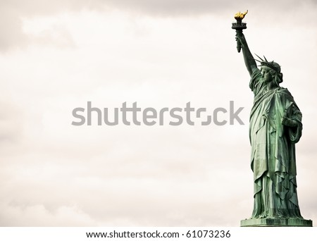 Statue of Liberty against dramatic clouds - stock photo