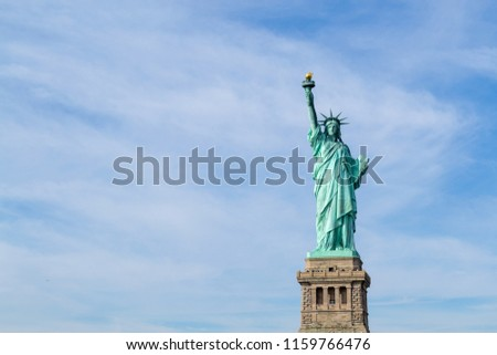 Statue of liberty  (dedicated on October 28, 1886) is one of the most famous icons of the USA #1159766476