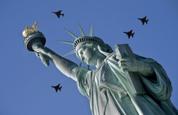 Statue of Liberty in NYC with jets flying overhead.