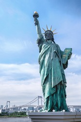 Statue of Liberty replica in Odaiba and Tokyo skyline behind, Japan