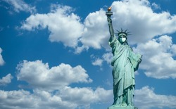 Statue of liberty wearing a surgical mask. Concept of pathogen coronavirus flu covid-19 outbrake in United States of America, corona virus pandemic US quarantine and isolation