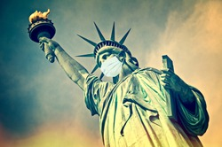 Statue of Liberty wearing a surgical mask. New coronavirus, covid-19 in New York and USA epidemic crisis concept