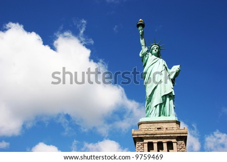 Statue of Liberty with deep blue skys and clouds