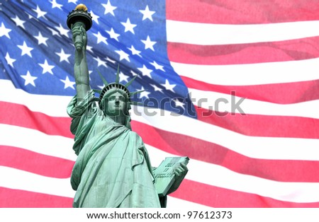 Statue of Liberty with the U.S. flag in the background.
