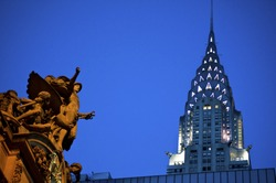 Statue of Mercury at Grand Central Terminal in New York City, with the Chrysler Building in the background