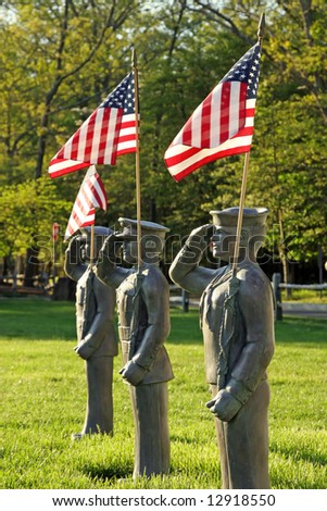 statue of military soldiers holding the American flag