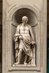 Statue of Niccola Pisano outside the Uffizi Gallery colonnade, Florence.