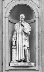 Statue of Niccolo Machiavelli in the niches of the Uffizi Gallery colonnade, Florence.