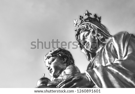 Statue of Our Lady, Mary and Jesus Christ, black and white picture.