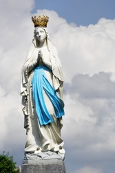 Statue of Our Lady of Immaculate Conception. Lourdes, France, major place of catholic pilgrimage.