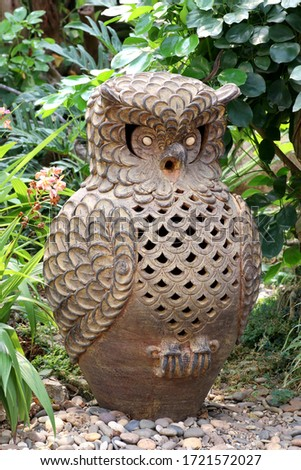Statue of owls in the beautiful green garden background stock photo