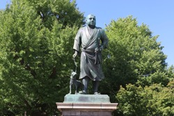 Statue of Saigō Takamori walking his dog. This statue was made in 1898.