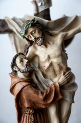 Statue of Saint Francis of Assisi embracing crucified Jesus. A private chapel.