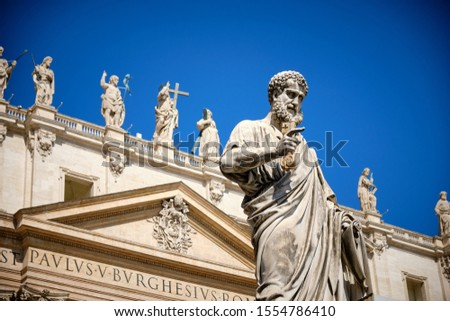 Photo of  Statue of Saint Peter and Saint Peter's Basilica at background in St. Peter's Square, Vatican City, Rome, Italy