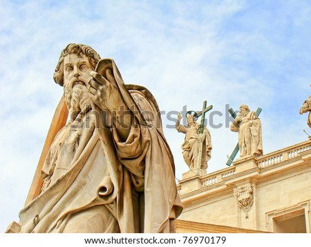 Statue of Saint Peter outside of the Papal Basilica of Saint Peter in Vatican City, Rome, Italy. On the background there's the statue of Jesus Christ, situated on the top of the basilica's facade.