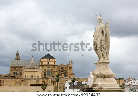 Statue of San Rafael in the Roman bridge and the cathedral mosque of Cordoba - Spain