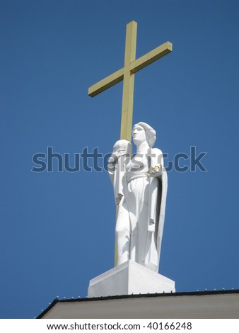Statue of St. Helena with the cross on the roof of the main cathedral in Vilnius, Lithuania