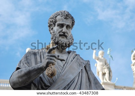 statue of St. Peter holding a key in St. Peter's Square at the Vatican
