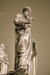 Statue of the Apostle Peter in St. Peter's square in the Vatican. Rome, Italy