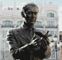 Statue of the famous poet, Federico García Lorca with a pigeon on Saint Anne Square (Plaza de Santa Ana) in Madrid, Spain, Europe.
