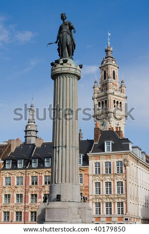 Statue of the French Revolution (built 1792), tower of the Chambre de Commerce and historical houses in the centre of Lille, France
