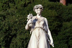 Statue of the goddess Flora, Piazza del Popolo Rome, sunset time.