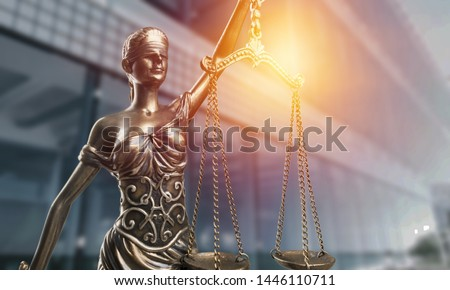 Statue of the lady of justice with scales close-up on the background of the judicial building