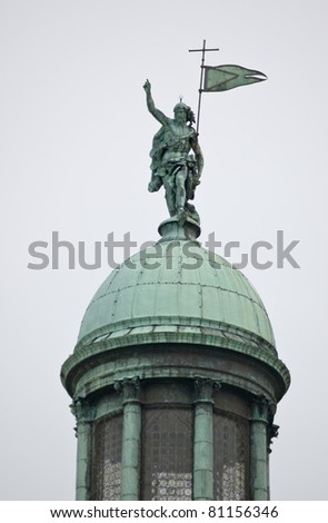 Statue of The Redeemer by Michele Fanolli on top of the dome of the church of San Simeon Piccolo in Venice, Italy. Statue erected in early 18th century.