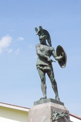 Statue of the Samnite warrior standing out against the sky. Pietrabbondante, Molise, Italy