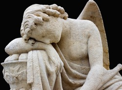 Statue of the tired angel. Pain, prayer and stress