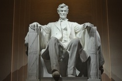 Statue of US President Abraham Lincoln inside the Lincoln Memorial at night, Washington D.C.