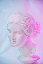 Statue of Venus de Milo. Creative concept colorful neon image with ancient greek sculpture Venus or Aphrodite head. Webpunk, vaporwave and surreal art style. Pink and blue duotone effects.