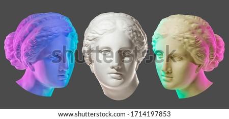 Statue of Venus de Milo. Creative concept colorful neon image with ancient greek sculpture Venus or Aphrodite head. Webpunk, vaporwave and surreal art style. Isolated on a black. Foto d'archivio ©