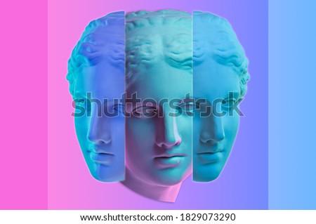 Statue of Venus de Milo. Creative concept colorful neon image with ancient greek sculpture Venus or Aphrodite head. Webpunk, vaporwave and surreal art style. Pink and blue duotone effects. Foto d'archivio ©