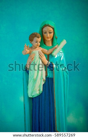 Statue of Virgin Mary holding the baby Jesus.