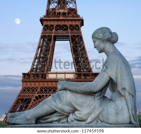 Statue of waiting woman on Trocadero and Eiffel tower in Paris, France.