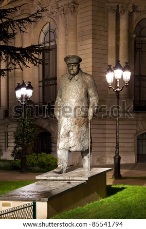 Statue of Winston Churchill near the Petit Palais in Paris at night. France.