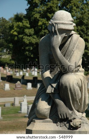 Statue of  woman in cemetery