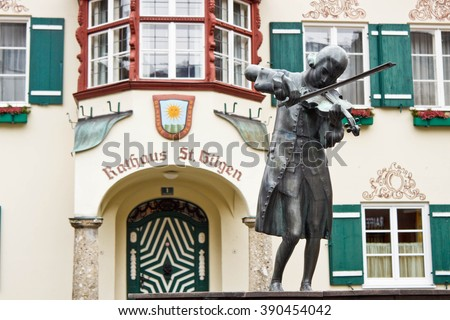 Statue of young Wolfgang Amadeus Mozart in front of townhall on Mozartplatz in St. Gilgen, Austria