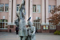 Statue of young women with grapes in front of the building, Rostov-on-Don, Russia (near Rostov conservatoire).
