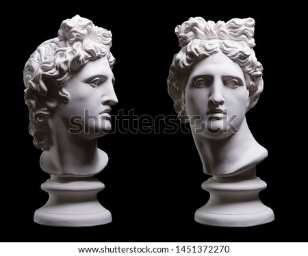 Statue. On a black isolated background. Gypsum statue of Apollo's head. Man.