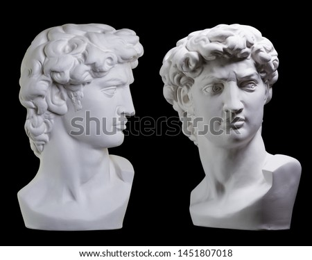 Statue. On a black isolated background. Gypsum statue of David's head. Man.
