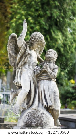 Statue on grave in the cemetery of Lviv, Ukraine.