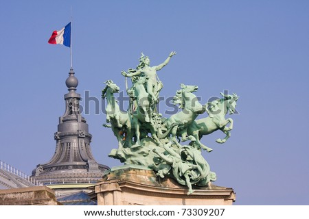 Statue on the Grand Palais in Paris, France, at the Champs Elysees, created for the Universal Exposition of 1900. The statue depicts Harmony triumphing over Discord.