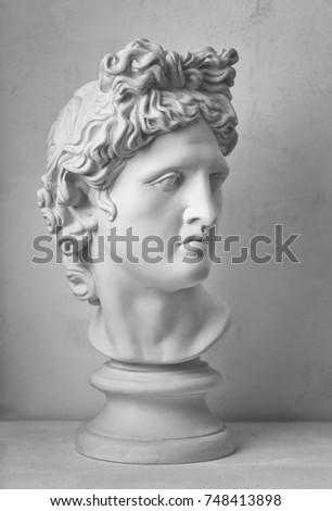 Statue. Plaster statue of Apollo's head. Isolated. Gypsum statue of Apollo's head. Man. Creative. Head. Plaster statue of David's head. Minimal concept art. Apollo Belvedere