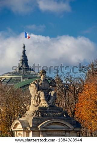 Statue representing Bordeaux on Place de la Concorde, Paris, France with French flag on background #1384968944